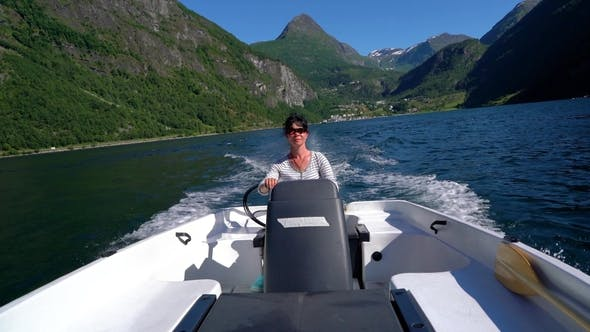 Thumbnail for Woman Driving a Motor Boat
