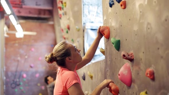 Thumbnail for Young Woman Exercising at Indoor Climbing Gym Wall 2