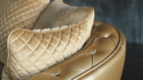 Elegant Gold Leather Texture with Buttons for Background and Design