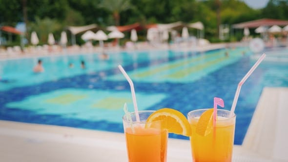 Thumbnail for A Luxurious Holiday for Two Lovers Two Glasses with an Orange Cocktail on the Background of a Huge