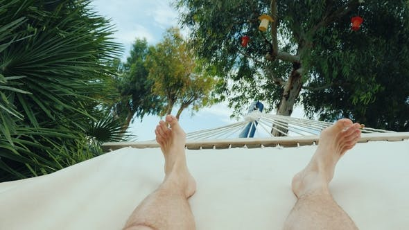Thumbnail for A Man Is Resting in a Hammock
