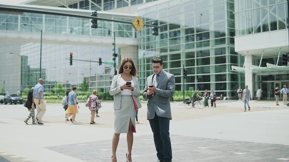 Thumbnail for Man and Woman Business People on the Sunny Day Talking About Work