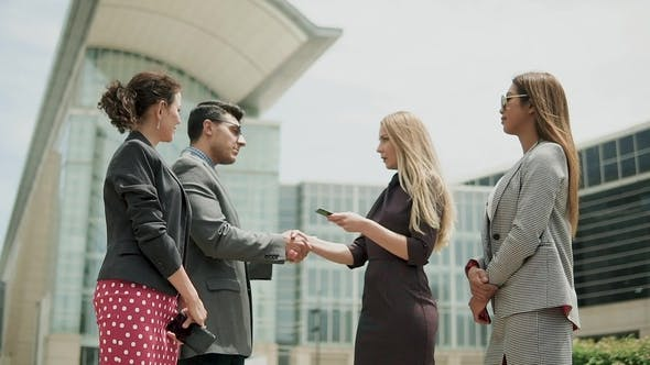 Thumbnail for Confident and Attractive Young Business Team Meet Up with Their Client and Shake Hands, in a Light