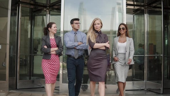 Thumbnail for A Group of Business People of Different Ethnicities Dressed in Suits and Ties Walks Proudly After