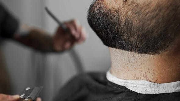 Thumbnail for Tattoed Barber Shears the Customer's Beard By Using Trimmer at the Barber Shop, Man's Haircut