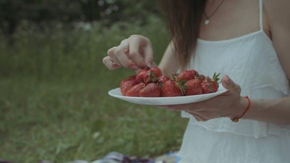 Thumbnail for Joyful Woman Eating Strawberry on Picnic