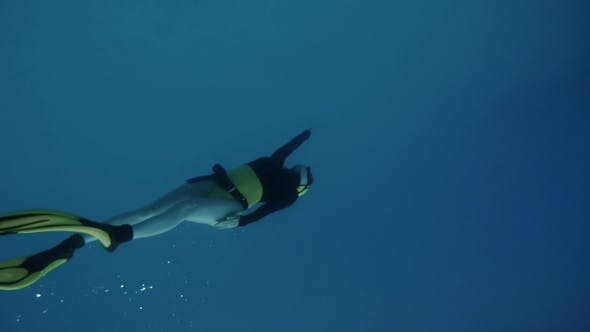 Thumbnail for A Young Woman Free Diving Deep Underwater