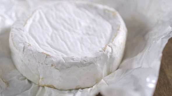 Thumbnail for The Head of the French Cheese on the Table on the Gray Background
