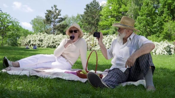 Thumbnail for Happy in Love Senior Couple at the Picnic in Summer Park