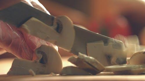 Cutting Champignons on Cutting Board
