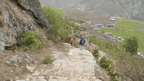 Thumbnail for Couple Walking Along the Stairs on the Trek Around Manaslu Village Prok, Nepal.