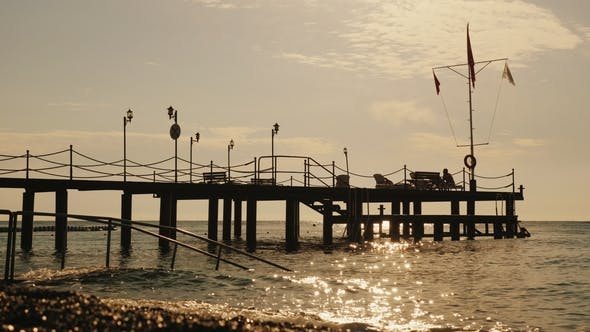 Thumbnail for Pier on the Turkish Shore, on the Flagstaff Turkish Flag. Early Morning at the Sea