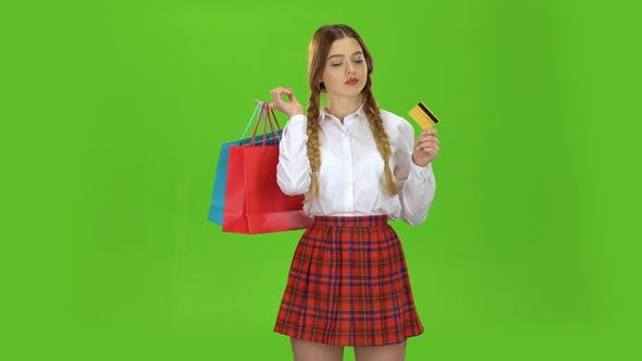 Thumbnail for Teenage Girl with a Credit Card and Packages in Her Hands