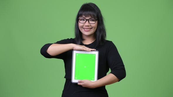 Thumbnail for Beautiful Asian Businesswoman Showing Digital Tablet
