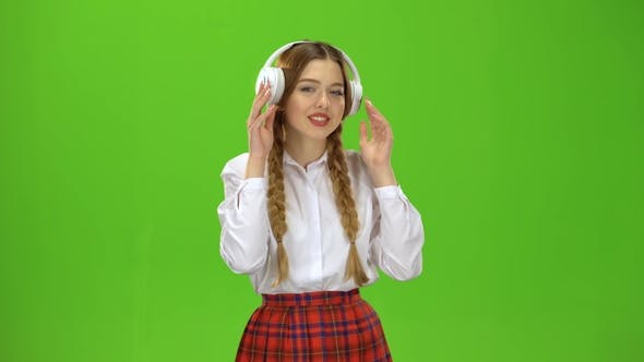 Cover Image for Girl Listens To Music on Headphones  Green Screen