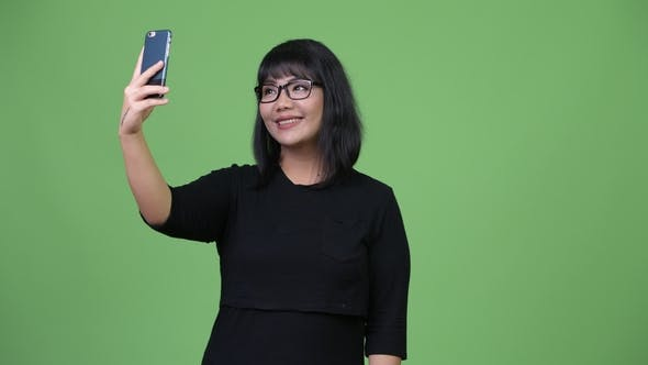 Thumbnail for Beautiful Asian Businesswoman Taking Selfie