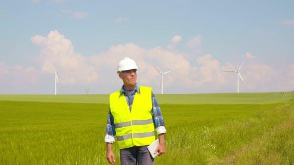 Thumbnail for Engineer Using Digital Tablet on Wind Turbine Farm