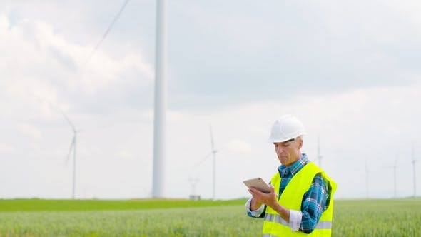Thumbnail for Engineer Using Digital Tablet When Doing Wind Turbine Inspection