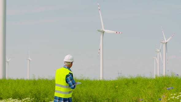 Thumbnail for Engineer Using Digital Tablet While Wind Turbine Inspection at Windmill Farm