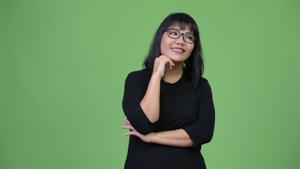 Thumbnail for Beautiful Happy Asian Businesswoman Smiling and Thinking