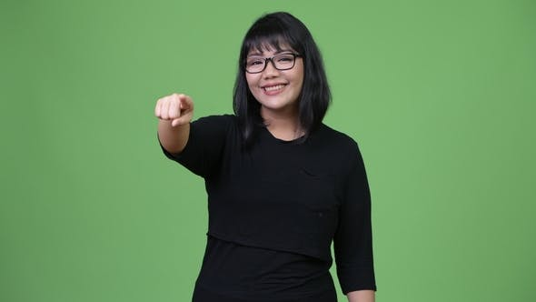Thumbnail for Beautiful Asian Businesswoman Pointing at Camera