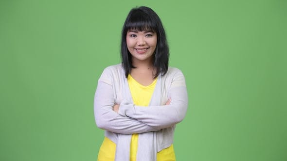 Thumbnail for Beautiful Happy Asian Woman Smiling with Arms Crossed