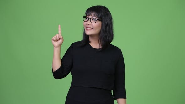 Thumbnail for Beautiful Asian Businesswoman Thinking While Pointing Finger Up