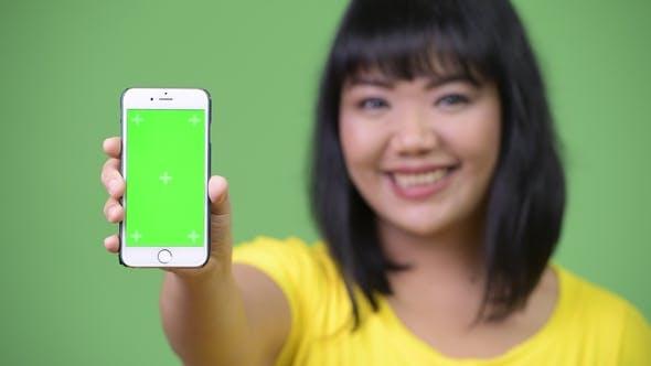 Thumbnail for Beautiful Happy Asian Woman Showing Phone