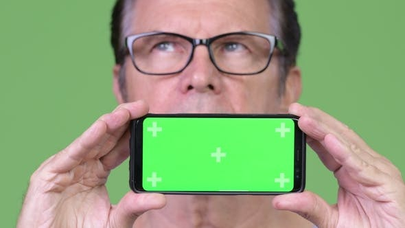 Cover Image for Senior Handsome Man Showing Phone and Thinking