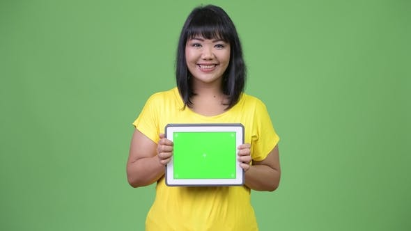 Thumbnail for Beautiful Happy Asian Woman Showing Digital Tablet