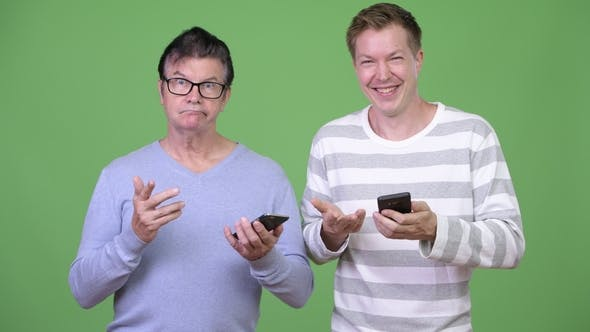 Thumbnail for Senior Handsome Man and Young Handsome Man Using Phone Together