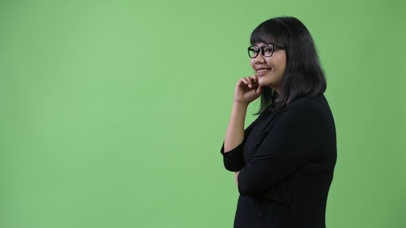 Thumbnail for Profile View of Beautiful Happy Asian Businesswoman Thinking