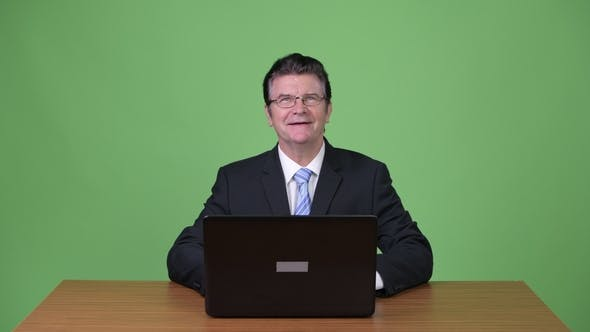 Thumbnail for Senior Handsome Businessman Using Laptop