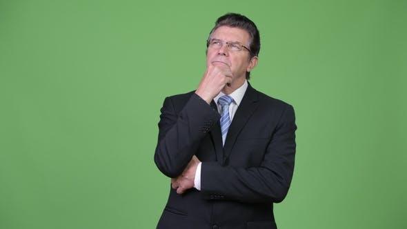 Thumbnail for Senior Handsome Businessman Thinking
