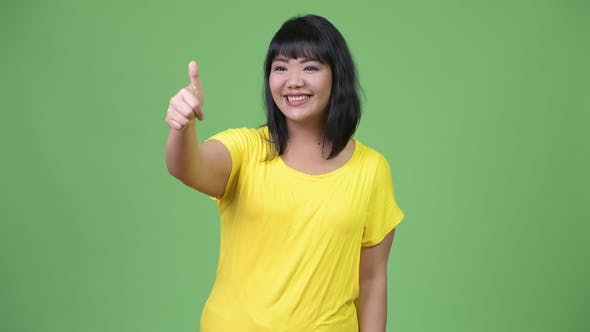 Thumbnail for Happy Asian Woman Giving Thumbs Up