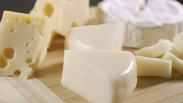 Thumbnail for Tasting Cheese Dish on a Wooden Plate. Food for Wine and Romantic, Cheese Delicatessen