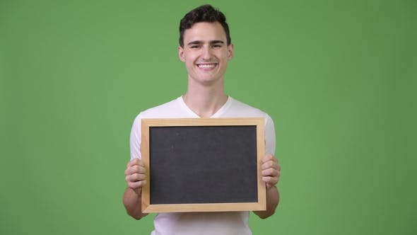 Thumbnail for Young Happy Handsome Man Holding Blackboard