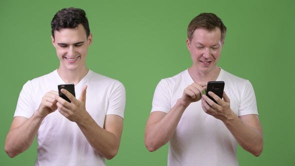 Thumbnail for Two Happy Young Handsome Men Using Phones Together
