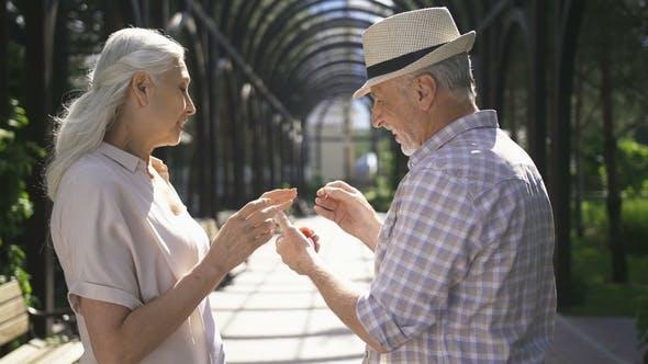 Engagement of Senior Couple Outdoors