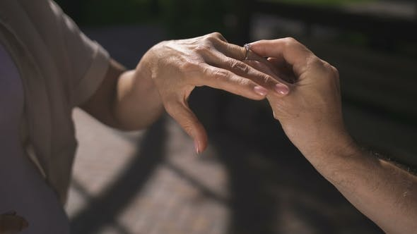 Cover Image for Senior Hands While Man Proposing To Woman