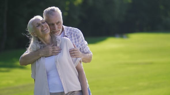 Thumbnail for Portrait of Passionate Senior Couple on Green Lawn