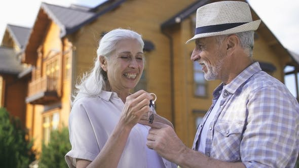 Thumbnail for Portrait of Aged Couple with House Keys