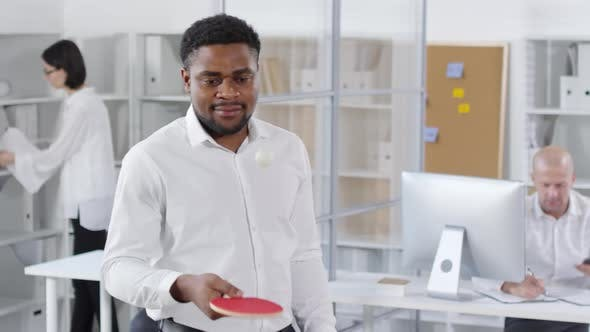 Thumbnail for Black Colleague Practicing Ping-Pong in Office