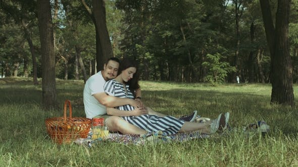 Thumbnail for Handsome Man Stroking Belly of His Pregnant Wife