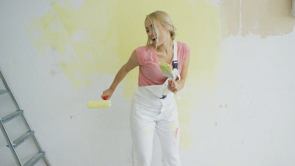 Thumbnail for Relaxed Woman Dancing with Paint Roller