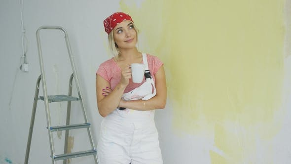 Thumbnail for Smiling Woman Painter Standing with Drink