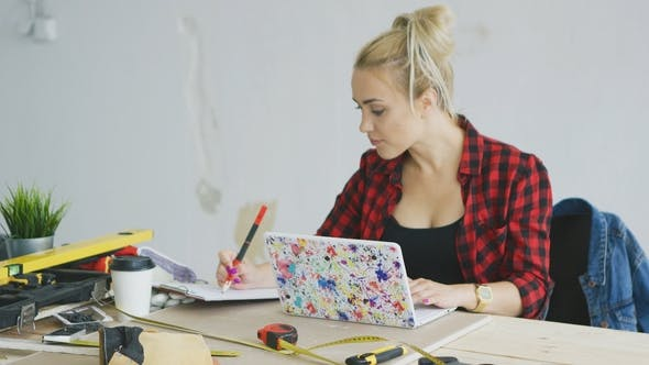 Thumbnail for Female with Laptop Writing in Notebook