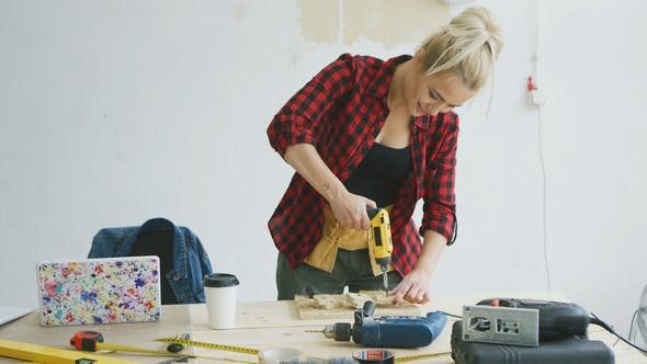 Thumbnail for Female Drilling Wooden Plank on Workbench