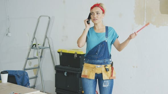 Thumbnail for Doing Home Repairs Woman Talking on Smartphone