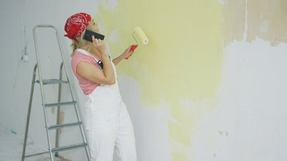 Thumbnail for Painting Wall Woman Talking on Smartphone